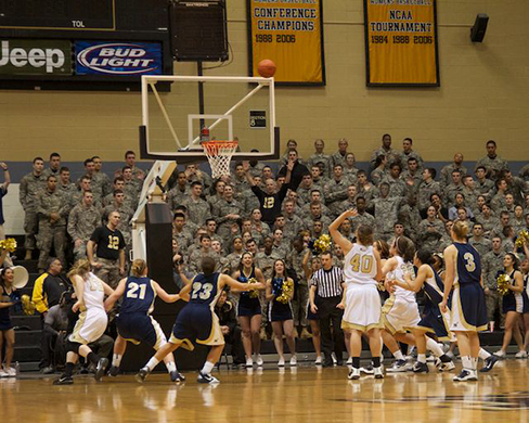 A photograph shows a basketball game.